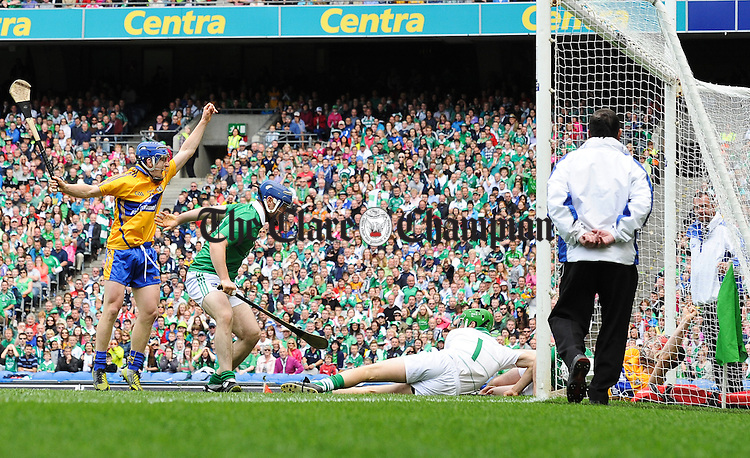 Darach Honan of Clare,(in net) with support from Podge Collins, left, scores a goal against Richie Mc Carthy and Nickie Quaid  of Limerick during the All-Ireland senior championship semi final at Croke Park. Photograph by John Kelly.