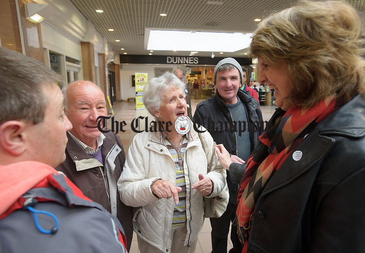 Joan Burton, Tanaiste and Minister for Social Protection, and Leader of the Labour Party chats with a voters in Dunnes Mall  on O Connell Street during a canvass of Ennis for a Yes vote in the forthcoming marriage referendum. Photograph by John Kelly.