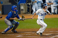 Kyle Seager #10 of the North Carolina Tar Heels follows through on his swing versus the Duke Blue Devils at Durham Bulls Athletic Park May 20, 2009 in Durham, North Carolina.  (Photo by Brian Westerholt / Four Seam Images)