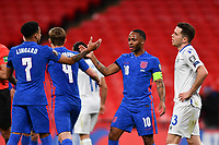 25th March 2021; Wembley Stadium, London, England;  Raheem Sterling England celebrates his goal with his teammates for 3-0 in the 30th minute during the World Cup 2022 Qualification match between England and San Marino at Wembley Stadium in London, England.