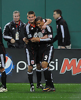 DC United forward Charlie Davies (9) celebrates his second goal of the game with team mate Perry Kitchen.  DC United defeated The Columbus Crew 3-1  at the home season opener, at RFK Stadium, Saturday March 19, 2011.