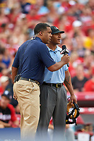 Umpire JJ January gets asked about a call being replayed on the screen during the All-Star Legends and Celebrity Softball Game on July 12, 2015 at Great American Ball Park in Cincinnati, Ohio.  (Mike Janes/Four Seam Images)