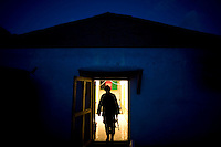 An Afghan National Army (ANA) soldier from Turkan Company, 2nd Brigade stands at the entrance to his barracks at Forward Operating Base (FOB) Blessing in the Pesh Valley.