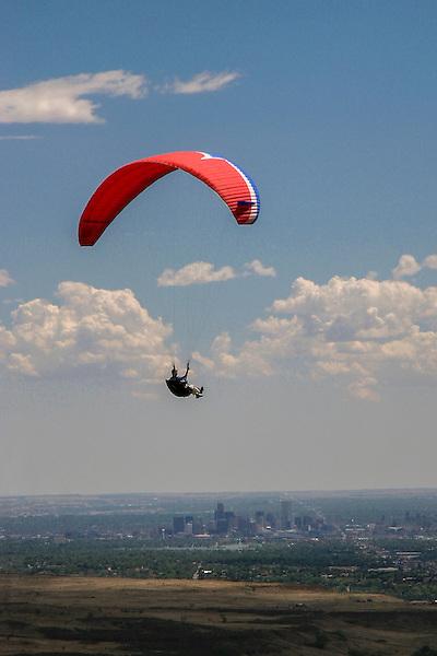 Paragliding with Denver skyline behind, Golden, Colorado,