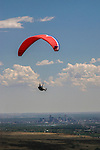 Paragliding with Denver skyline behind, Golden, Colorado,