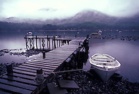 Rowboat moored by pier<br />