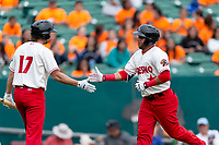 Fresno Grizzlies outfielder Yadiel Hernandez (13) is congratulated by starting pitcher Brady Dragmire (17) after hitting a home run during a game against the Reno Aces at Chukchansi Park on April 8, 2019 in Fresno, California. Fresno defeated Reno 7-6. (Zachary Lucy/Four Seam Images)