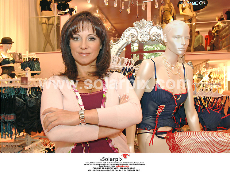 PICTURES FROM SOLARPIX.COM..Jacqueline Gold, owner of Ann summers at her store in Valencia during filming for the brand new LIvingTV show, Break With The Boss...DATE: 13/10/2006-JOB REF: 2920-ITS.
