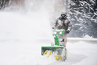 Bentonville Parks and Recreation Maintenance Crew Member Jon Wilson uses a snow plow, Monday, February 15, 2021 at Lawrence Plaza in Bentonville. Check out nwaonline.com/210216Daily/ for today's photo gallery. <br /> (NWA Democrat-Gazette/Charlie Kaijo)