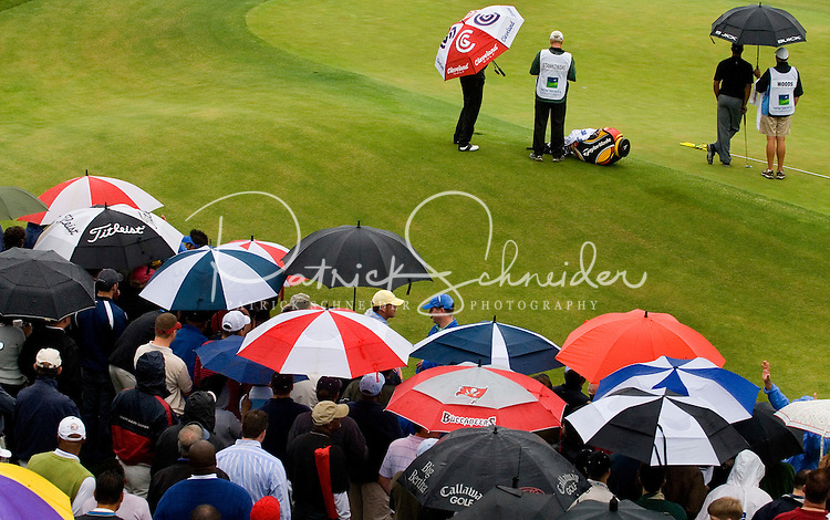 Fans open umbrellas in a rain storm during the 2007 Wachovia Championships at Quail Hollow Country Club in Charlotte, NC.