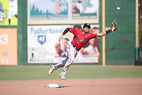 Isaac Collins (2) of the Fresno Grizzlies reaches for an errant throw during a game against the Inland Empire 66ers at San Manuel Stadium on May 25, 2021 in San Bernardino, California. (Larry Goren/Four Seam Images)