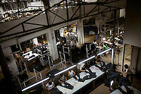 """Textile workers sewing jeans. China, the """"factory of the world"""", is now one of the world's largest producers of jeans and its textile workers are among the 200 million migrant labourers criss-crossing the country looking for a better life."""