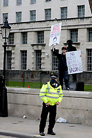 """LONDON, ENGLAND - OCTOBER 10: A rally on October 10, 2020 in London, England. Demonstrators rallied against the COVID-19 measures a day after London's Mayor Sadiq Khan announced new restrictions 'inevitable'. The World Health Organization (WHO) health agency announced """"no new answers"""" to the coronavirus pandemic and reporting a worldwide record of 350,000 new daily cases.<br /> CAP/IH<br /> ©Ivan Harris/Capital Pictures"""