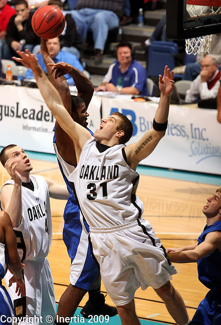 SIOUX FALLS, SD - MARCH 8:  Drew Maynard #31 of Oakland streches for a rebound against IPFW in the first half of their quarterfinal game of the Summit League Championship Sunday night at the Arena in Sioux Falls. (Photo by Dave Eggen/Inertia)