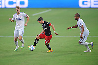 WASHINGTON, DC - AUGUST 25: Joseph Mora #28 of D.C. United battles for the ball with Teal Bunbury #10 and Adam Buska #9 of New England Revolution during a game between New England Revolution and D.C. United at Audi Field on August 25, 2020 in Washington, DC.