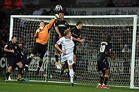 Pictured: Keiren Westwood goalkeeper for Coventry City (in orange) punches the ball away with the support of team mate Leon McKenzie (top) and other players, preventing Garry Monk of Swansea (in white) to score. <br /> Re: Coca Cola Championship, Swansea City FC v Coventry City at the Liberty Stadium. Swansea, south Wales, Friday 26 December 2008.<br /> Picture by D Legakis Photography / Athena Picture Agency, Swansea 07815441513