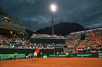 Austria, Kitzbühel, Juli 17, 2015, Tennis, Davis Cup, Second match between Robin Haase (NED and Andreas Haider-Maurer (AUT), pictured : Robin Haase serves while a thunderstorm moves over and play gets suspended<br /> Photo: Tennisimages/Henk Koster