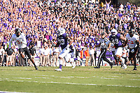 TCU tailback B.J. Catalon (23) rushes towards the end zone for a touchdown during an NCAA football game, Saturday, October 18, 2014 in Fort Worth, Tex. TCU leads Oklahoma State 28-9 at the halftime. (Mo Khursheed/TFV Media via AP Images)