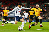 Son Heung-min of Tottenham Hotspur is challenged by Dan Butler of Newport County during the Fly Emirates FA Cup Fourth Round Replay match between Tottenham Hotspur and Newport County at Wembley Stadium, London, England, UK. 07 February 2018
