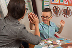 Sight word identification for kindergarten student at home, working with mother, special needs student, getting high five from mother for correct IDs