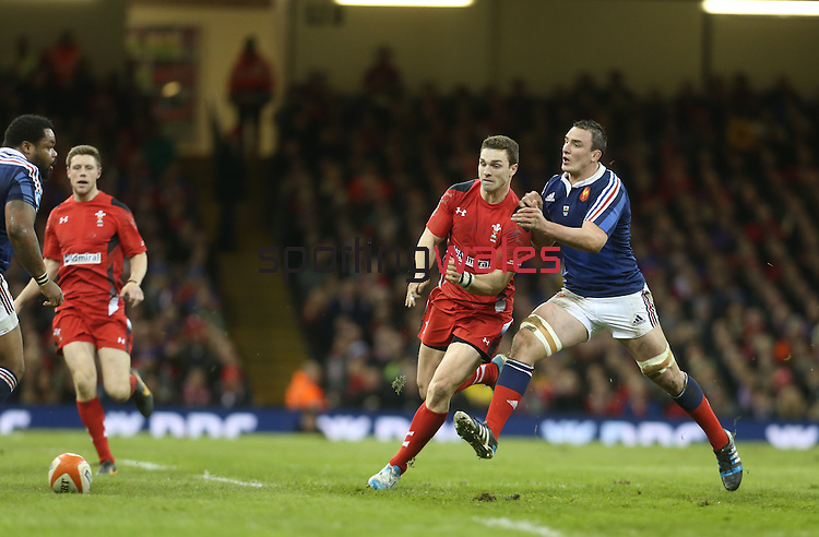 Wales center George North and French number 8 Louis Picamoles compete for the loose ball.<br /> RBS 6 Nations 2014<br /> Wales v France<br /> Millennium Stadium<br /> 21.02.14<br /> <br /> ©Steve Pope-SPORTINGWALES
