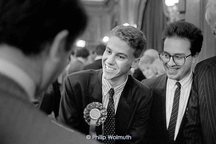 Nicholas Markham and David Berens are congratulated after winning the Cavendish ward of Westminster City Council for the Conservatives and unseating Paul Dimoldenberg, leader of the Westminster City Council Labour group. 1990 local election count, Porchester Hall, London. The Conservatives, later found guilty of gerrymandering, increased their majority from 4 to 38 seats.