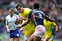 Ed Jenkins of Australia forces his way past Nick Edwards of the United States during the iRB Marriott London Sevens at Twickenham on Saturday 11th May 2013 (Photo by Rob Munro)