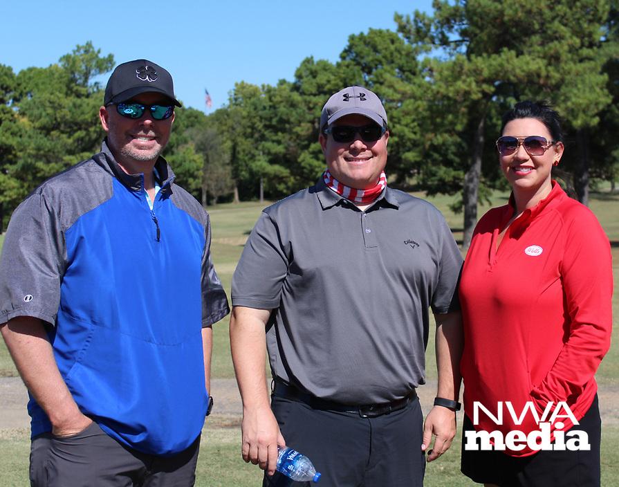 Tony Brown (from left), Jason Wright and Monique Swindle enjoy The Golf Event on Oct. 5.<br /> (NWA Democrat-Gazette/Carin Schoppmeyer)