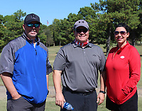 Tony Brown (from left), Jason Wright and Monique Swindle enjoy The Golf Event on Oct. 5.<br />