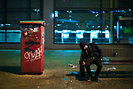 © Joel Goodman - 07973 332324 . 07/04/2017 . Manchester , UK . A man , believed to be suffering the effects of Spice , sits slumped on his side on a bench in Piccadilly . Greater Manchester Police have authorised dispersal powers and say they will ban people from the city centre for 48 hours , this evening (7th April 2017) , in order to tackle alcohol and spice abuse . Photo credit : Joel Goodman