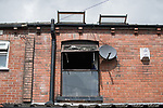 © Joel Goodman - 07973 332324 . 09/07/2017 . Bolton , UK . GV of the scene on Rosamond Street in Daubhill , where a fatal house fire burned through a mid-terrace house yesterday morning (Saturday 8th July 2017) . Anisha Umerji (40) her two sons Hammad (12) and Yusuf (ten) and her daughter Khadija (five) all died in the blaze. Their father Zubair (Anisha's husband) remains in hospital . Photo credit : Joel Goodman