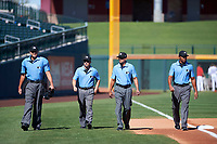 Arizona Fall League umpires Ryan Addition, Nick Mahrley, Roberto Ortiz, and Jeremie Rehak walk onto the field prior to an Arizona Fall League game between the Mesa Solar Sox and the Scottsdale Scorpions on October 24, 2017 at Sloan Park in Mesa, Arizona. The Scorpions defeated the Solar Sox 3-1. (Zachary Lucy/Four Seam Images)