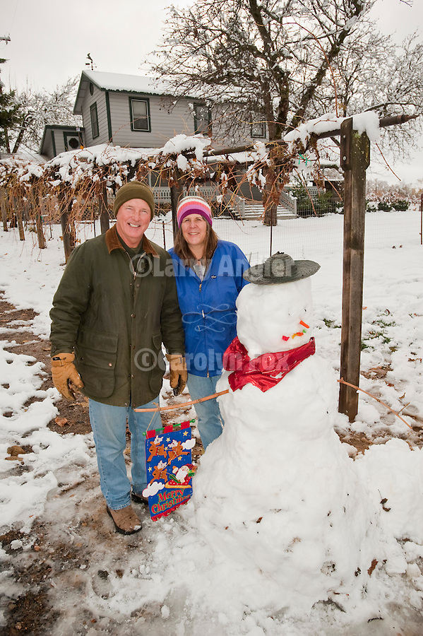 Terri Harvey and her friend create a snowman at her home in California's Shenandoah Valley.