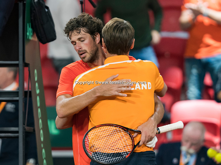 The Hague, The Netherlands, September 17, 2017,  Sportcampus , Davis Cup Netherlands - Chech Republic, Robin Haase (NED) wins the match and equals the score 2-2 and is embraced by captain Paul Haarhuis<br /> Photo: Tennisimages/Henk Koster