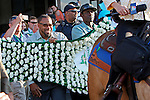 June 6, 2015: The blanket of carnations to be placed on the Belmont winner is carried to the track as the horses enter the post parade. American Pharoah, Victor Espinoza up, wins the 147th running of the Grade I  Belmont Stakes and with it the Triple Crown at Belmont Park, Elmont, NY.  Joan Fairman Kanes/ESW/CSM
