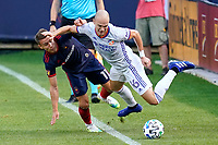 CHICAGO, UNITED STATES - AUGUST 25: Przemyslaw Frankowski #11 of Chicago Fire battles with Andrew Gutman #96 of FC Cincinnati during a game between FC Cincinnati and Chicago Fire at Soldier Field on August 25, 2020 in Chicago, Illinois.