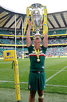 Jordan Crane of Leicester Tigers holds the trophy aloft after the Aviva Premiership Final between Leicester Tigers and Northampton Saints at Twickenham Stadium on Saturday 25th May 2013 (Photo by Rob Munro)