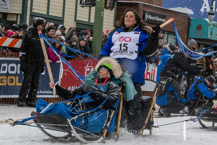Karin Hendrickson and team leave the ceremonial start line with an Iditarider and handler at 4th Avenue and D street in downtown Anchorage, Alaska on Saturday March 7th during the 2020 Iditarod race. Photo copyright by Cathy Hart Photography.com