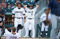 Danny Mendick (17) of the Charlotte Knights reacts after Charlie Tilson (4) was thrown out at home plate attempting an inside-the-park home run against the Toledo Mud Hens at BB&T BallPark on April 24, 2019 in Charlotte, North Carolina. The Knights defeated the Mud Hens 9-6. (Brian Westerholt/Four Seam Images)