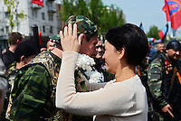 A demonstartor kisses a Pro-Russian soldier during the celebrations of the Victory Day, the Soviet holiday commemorating the defeat of the Nazis.  Sunday is May 11, the proposed date for the separatists' referendum on greater autonomy for eastern Ukraine. Donetsk, Ukraine