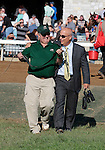 """LEXINGTON, KY - OCTOBER 12: Mark Casse entering the winners circle after winning the JPMorgan Chase Jessamine with #2 La Coronel and jockey Florent Geroux a """"Win and You're In Juvenile Fillies Turf Division"""" for owner John Oxley at Keeneland Race Course.  October 12, 2016, Lexington, Kentucky. (Photo by Candice Chavez/Eclipse Sportswire/Getty Images)"""
