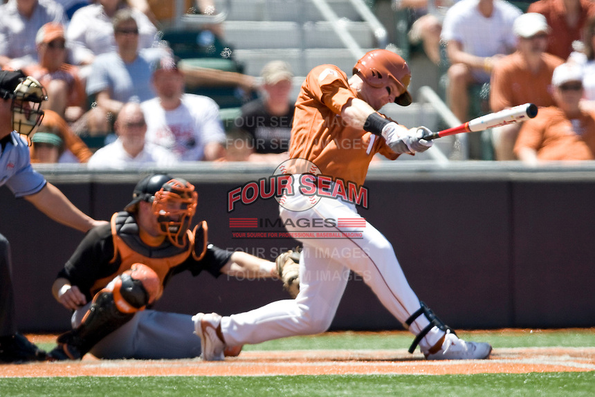 Texas Lonhorn 1B Kevin Lusson hits against Oklahoma State on Sunday April 25th, 2010 at UFCU Dish-Falk Field in Austin, Texas.  (Photo by Andrew Woolley / Four Seam Images)
