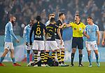 MFF-AIK, Allsvenskan 10282019. AIK's Karol mets and MFF's Eric Larsson with referee Bojan Pandzic.