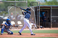 AZL Padres 1 third baseman Carlos Luis (25) follows through on his swing in front of catcher Stephan Vidal (13) during an Arizona League game against the AZL Royals at Peoria Sports Complex on July 4, 2018 in Peoria, Arizona. The AZL Royals defeated the AZL Padres 1 5-4. (Zachary Lucy/Four Seam Images)