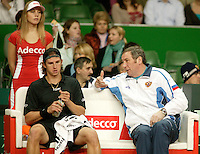 12-2-06, Netherlands, tennis, Amsterdam, Daviscup.Netherlands Russia, captain Shamil Tarpischev and Igor Andreev on the Russian bench