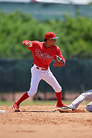 GCL Phillies West shortstop Christian Valerio (45) throws to first base during a Gulf Coast League game against the GCL Yankees East on August 3, 2019 at the Carpenter Complex in Clearwater, Florida.  The GCL Yankees East defeated the GCL Phillies West 4-0, the second game of a doubleheader.  (Mike Janes/Four Seam Images)