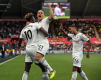 (L-R) Tammy Abraham of Swansea City celebrates his equaliser with team mates Roque Mesa and Kyle Naughton during the Premier League match between Swansea City and Watford at The Liberty Stadium, Swansea, Wales, UK. Saturday 23 September 2017