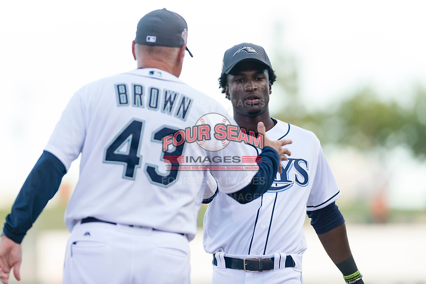 AFL West shortstop Lucius Fox (5), of the Peoria Javelinas and Tampa Bay Rays organization, prepares to shake hands with manager Daren Brown (43) during player introductions before the Arizona Fall League Fall Stars game at Surprise Stadium on November 3, 2018 in Surprise, Arizona. The AFL West defeated the AFL East 7-6 . (Zachary Lucy/Four Seam Images)
