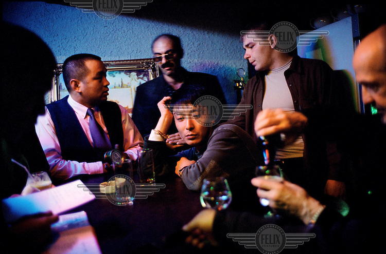 Chinese and Russian businessmen share a drink close to the Sino-Russian border.