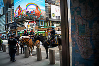 """NEW YORK, NEW YORK - SEPTEMBER 3: NYPD officers gather at Times Square on September 3, 2020 in New York. U.S. President Trump has ordered to the federal government to begin the process to defund NYC and three other cities where protest """"lawless"""" were allowed and police budgets were cut, rising violent crime. (Photo by Eduardo MunozAlvarez/VIEWpress via GettyImages)"""